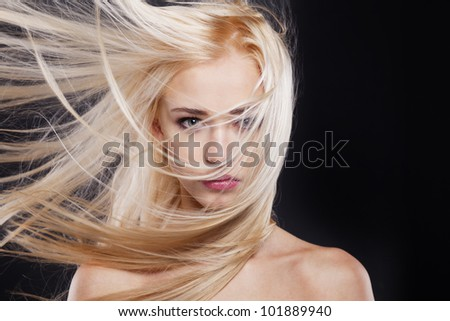 Fashion Portrait of beautiful blonde with the flying hair - stock photo