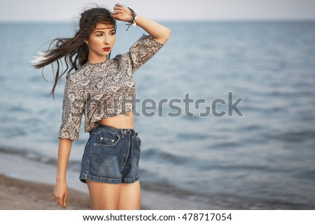 Fashion portrait of beautiful hippie young woman in the seaside. Boho style. Lifestyle concept.