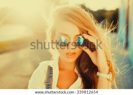 Fashion portrait of beautiful hippie young woman wearing boho chic clothes and summer hat outdoors. Soft warm vintage color tone. Artsy bohemian style.Sunset colors,amazing tan skin,glowing skin - stock photo