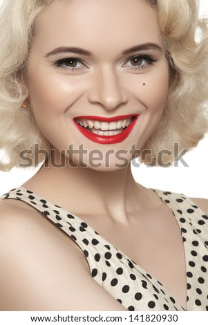 Fashion portrait of beautiful laughing woman model with red lips make-up and long curly blond hair on white background. Pin-up retro style. Healthy happy smile with white teeth - stock photo