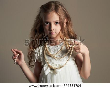 fashion portrait of beautiful little girl.pretty little princess - stock photo