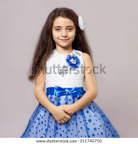 fashion portrait of beautiful little girl with flower in her hair.pretty little funny child.princess dress - stock photo