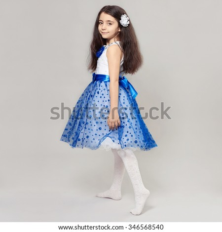 fashion portrait of beautiful little girl with flower in her hair.pretty little princess child - stock photo