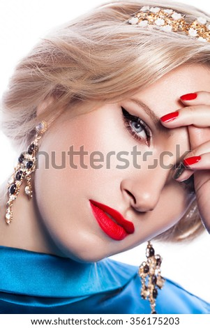 Fashion Portrait Of Beautiful Luxury Woman With Jewelry and red lipstick