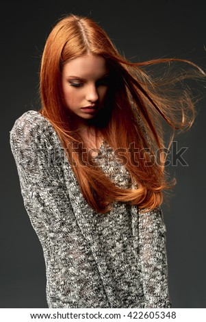 Fashion portrait of beautiful red haired fashion model girl with long flying hair  - stock photo