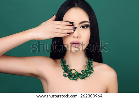 fashion portrait of beautiful sensual woman with dark straight hair with bright makeup and necklace  - stock photo