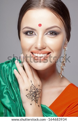 fashion portrait of beautiful woman in indian sari - stock photo