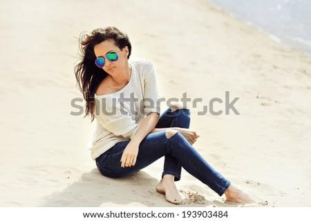Fashion portrait of beautiful woman in sunglasses - stock photo