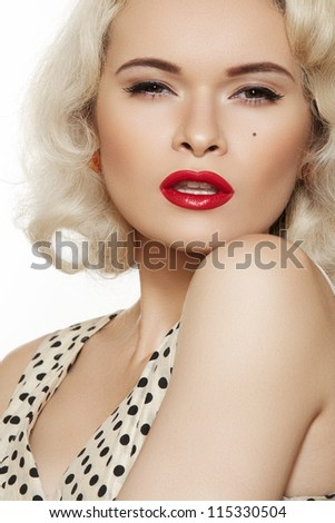 Fashion portrait of beautiful woman model with red lips make-up and long curly blond hair. Pin-up retro style. Pretty blond coquette model like Marilyn Monroe in vintage dress with peas print. - stock photo