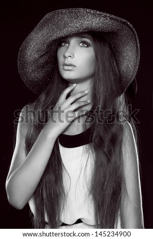 Fashion portrait of beautiful  woman posing in hat, black and white photo - stock photo