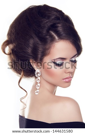 Fashion portrait of Beautiful woman with curly hair and evening make-up. Jewelry and Beauty.  Isolated on white background. - stock photo