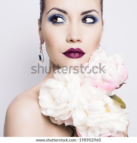 Fashion portrait of beautiful young lady with peonies - stock photo