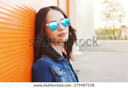Fashion portrait of beautiful young woman in the sunglasses - stock photo
