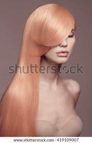 fashion portrait of beautiful young woman with long healthy colored hair.beauty model girl in underwear.haircare cosmetics concept