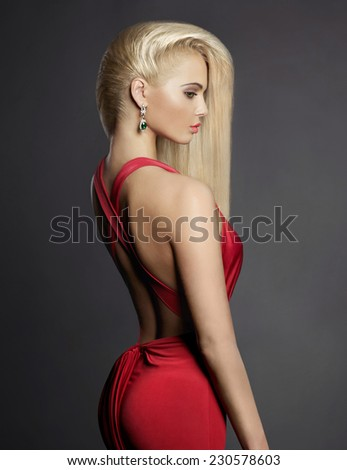 Fashion portrait of elegant blond woman in red dress