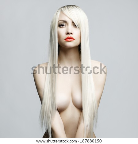 Fashion portrait of elegant woman with helthy luxurious hair - stock photo