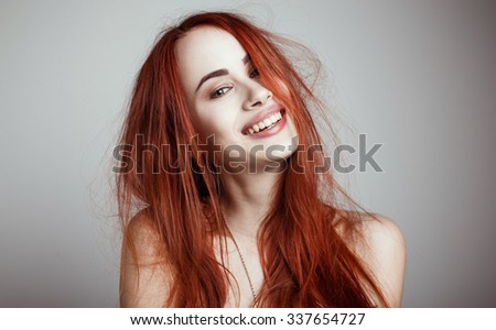 Fashion portrait of elegant woman with magnificent hair and awesome lips. Redhead girl. Perfect make-up. Hairstyle.