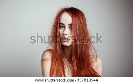 Fashion portrait of elegant woman with magnificent hair and awesome lips. Redhead girl. Perfect make-up. Hairstyle. - stock photo