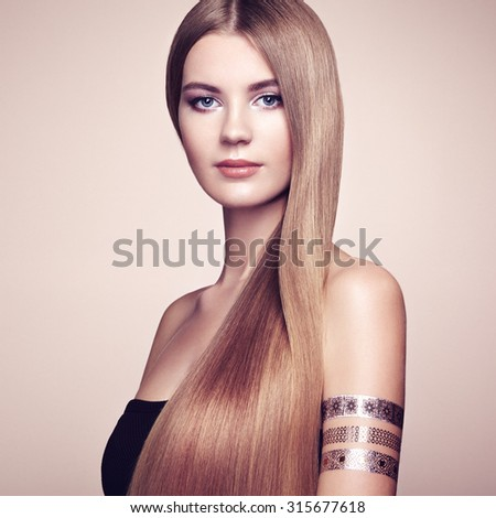 Fashion portrait of elegant woman with magnificent hair. Blonde girl. Perfect make-up. Girl in elegant dress. Flash tattoo gold - stock photo
