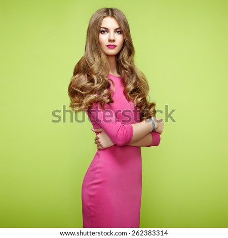 Fashion portrait of elegant woman with magnificent hair. Blonde girl. Perfect make-up. Girl in pink dress on green background - stock photo