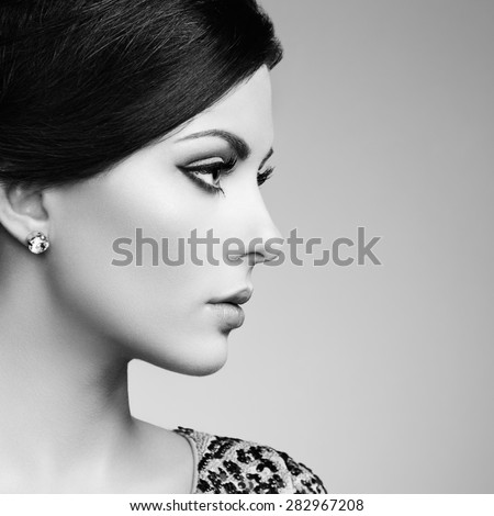 Fashion portrait of elegant woman with magnificent hair. Brunette girl. Perfect make-up