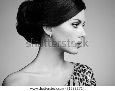 Fashion portrait of elegant woman with magnificent hair. Brunette girl. Perfect make-up. Black and white