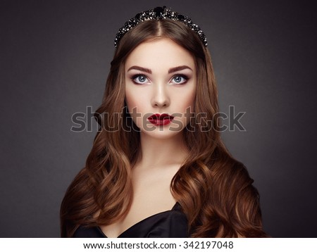 Fashion portrait of elegant woman with magnificent hair. Brunette girl. Perfect make-up. Girl in black dress. Curly hair - stock photo