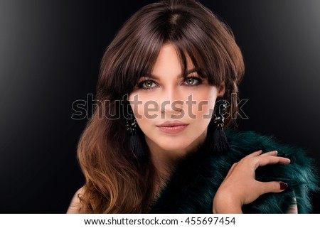 Fashion portrait of elegant young woman with brunette long hair and perfect glamour makeup. Beauty photo. - stock photo