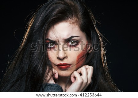 Fashion portrait of emotional woman in the dark - stock photo
