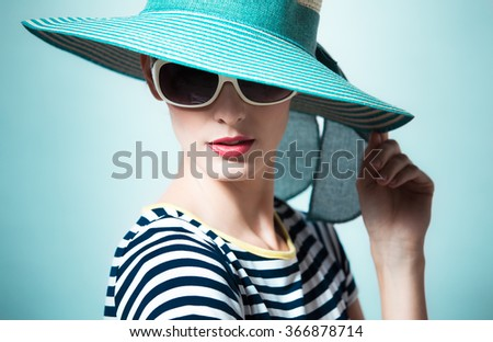 Fashion portrait of female with hat.  - stock photo