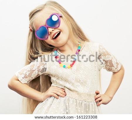 Fashion portrait of girl child. Sunglasses. - stock photo