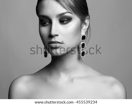 fashion portrait of girl in jewelry. beautiful sexy woman - stock photo