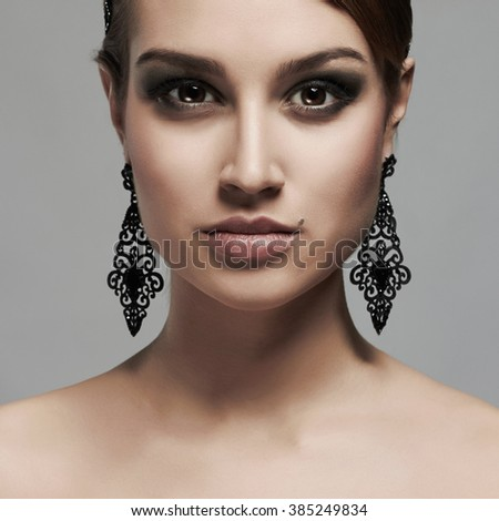 fashion portrait of girl in jewelry. beautiful sexy woman with make-up - stock photo