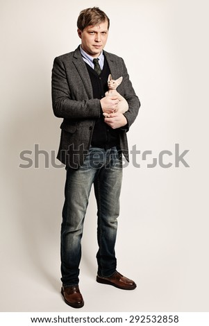 Fashion Portrait of Handsome Man with Little Kitten - stock photo