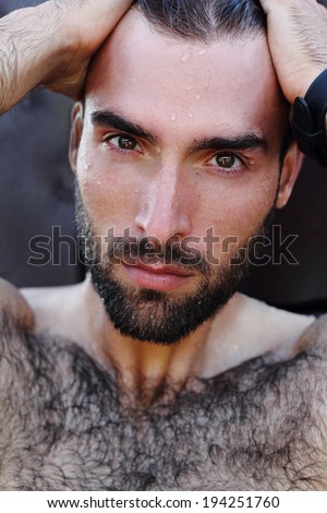 Fashion Portrait of handsome masculine guy with drop of water on ��° face with Brown dark eyes Beard and mustache - stock photo