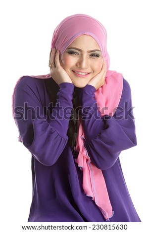 Fashion portrait of happy young beautiful asian muslim woman with wearing hijab - stock photo