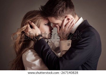 Fashion portrait of lovers. Sensual portrait of cute couple. - stock photo