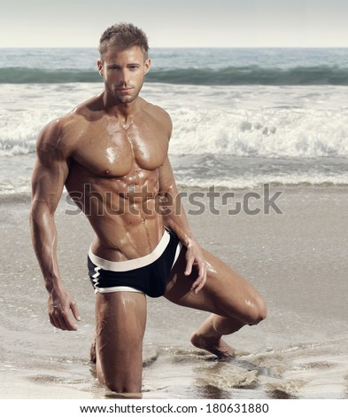 Fashion portrait of muscular fitness model man - stock photo