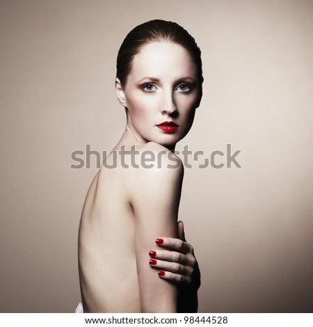 Fashion portrait of nude elegant woman. Studio photo - stock photo