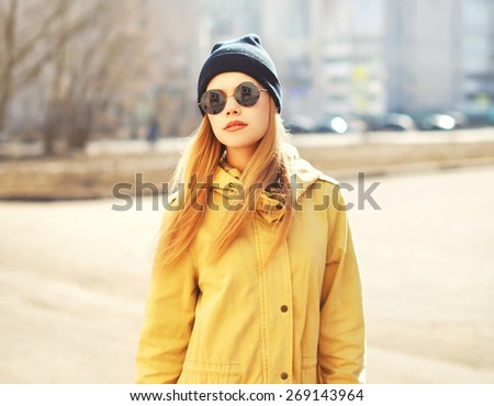 Fashion portrait of pretty hipster blonde girl outdoors in sunny day - stock photo