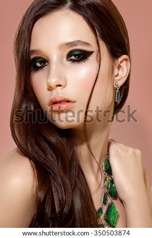 fashion portrait of sensual stylish girl with bright make up and jewelers