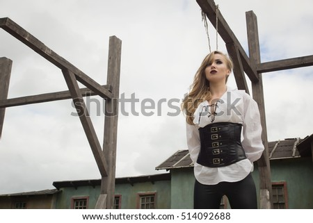 Fashion portrait of sexy woman in pirate style as prisoner