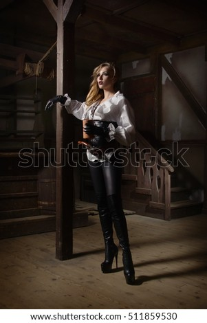 Fashion portrait of sexy woman in pirate style at tavern