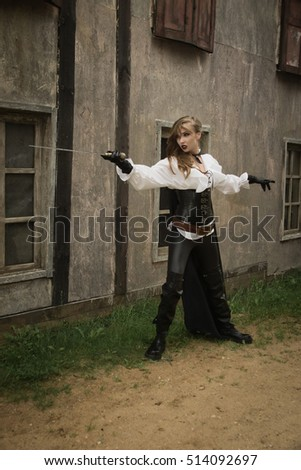Fashion portrait of sexy woman in pirate style holding sword