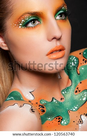 fashion portrait of sexy woman with creative face art - stock photo