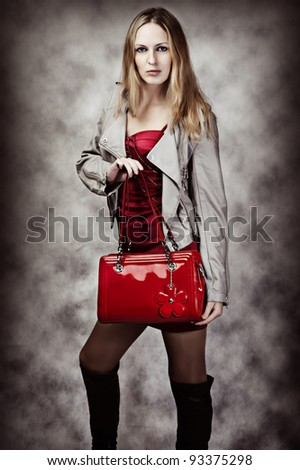 Fashion portrait of sexy woman with red fashionable patent leather bag - stock photo