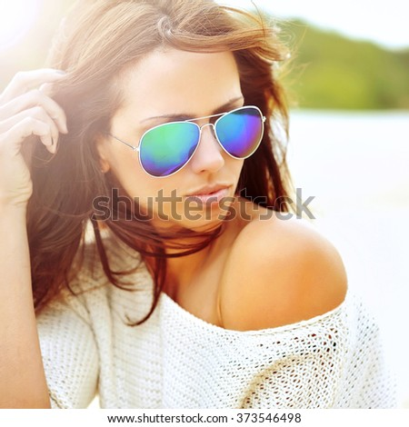 Fashion portrait of stylish woman in sunglasses  - stock photo