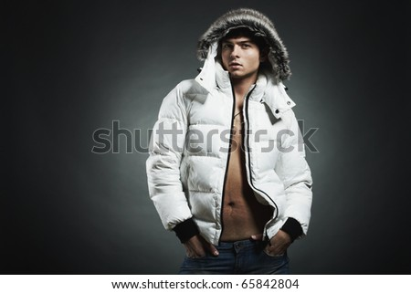 Fashion portrait of the young beautiful man in a white jacke - stock photo