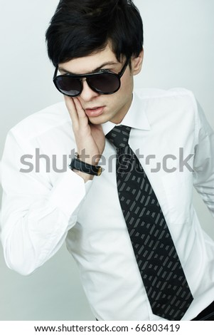 Fashion portrait of the young businessman - stock photo