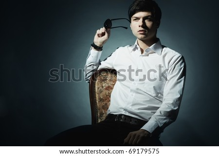 Fashion portrait of the young businessman. Shooting in studio
